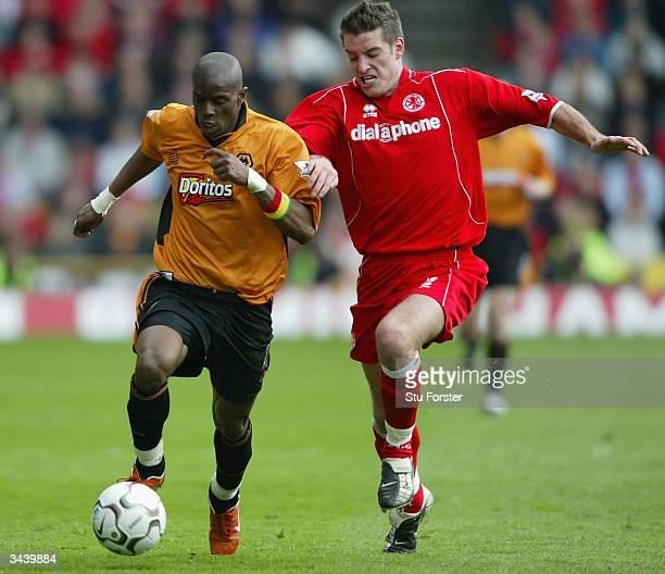 Wolves striker Henri Camara battles with Franck Queudrue during the FA Barclaycard Premiership match between Wolverhampton Wanderers and...