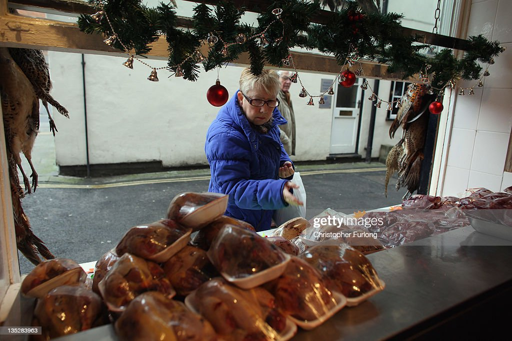 A woma shops at Andrew Francis butchers in the rural town of Ludlow in Shropshire on December 8, 2011 in Ludlow, England. With a weak outlook at the start of the Christmas shopping boom, many retailers are slashing prices with the hopes of combating poor sales.