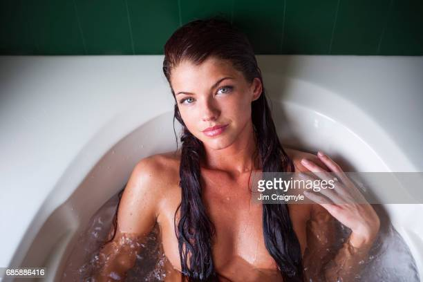 woman 20's taking a bath - adults only stock pictures, royalty-free photos & images