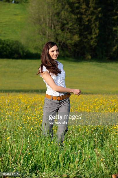 Woman, 22 years, in a spring meadow