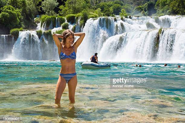 woman, 35 years old, bathing in the krka waterfalls, krka national park, dalmatia, croatia, europe - 30 39 years stock-fotos und bilder