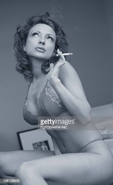 woman 6 - beautiful women smoking cigarettes stock photos and pictures
