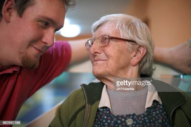 Woman, 89 years, talking to a nurse for the elderly, nursing home