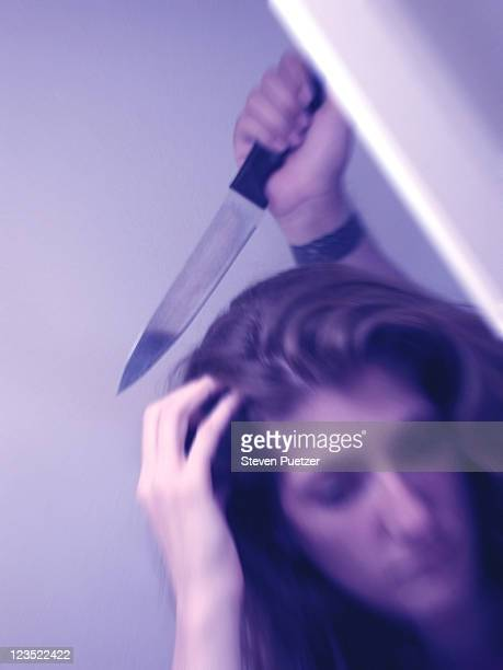Woman about to be stabbed