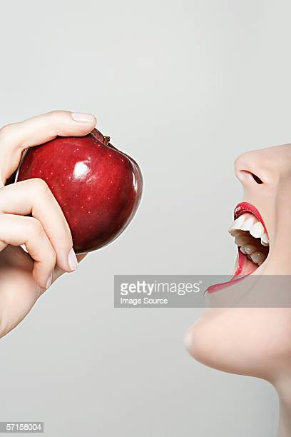 Woman about to bite into apple