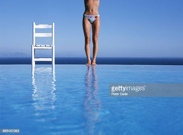 Woman about to dive into pool