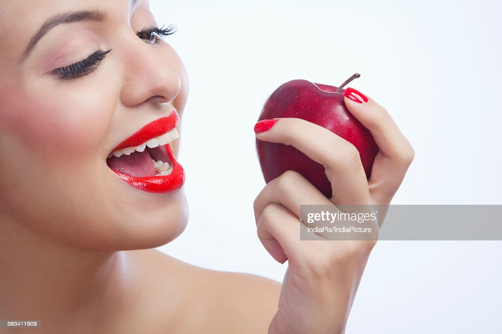 Woman about to eat an apple : Stock Photo