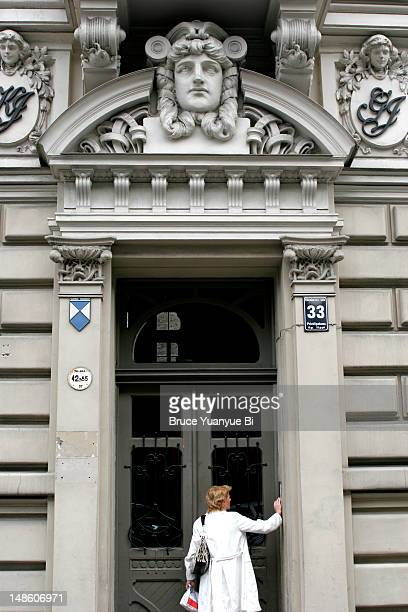 Woman about to enter No 33 on Elizabetes Street, famous Art Nouveau building in new town of Riga.