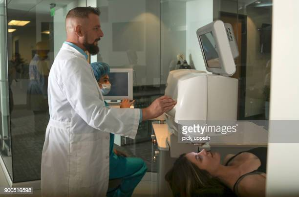 woman about to get lasik surgery - retinal scan stock pictures, royalty-free photos & images