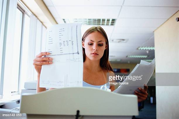 Woman about to shred paper