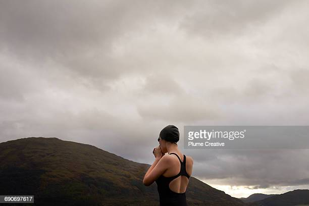 Woman about to swim in Scottish loch