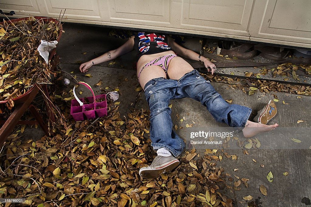 Woman Accident Under Garage Door Stock Photo Getty Images