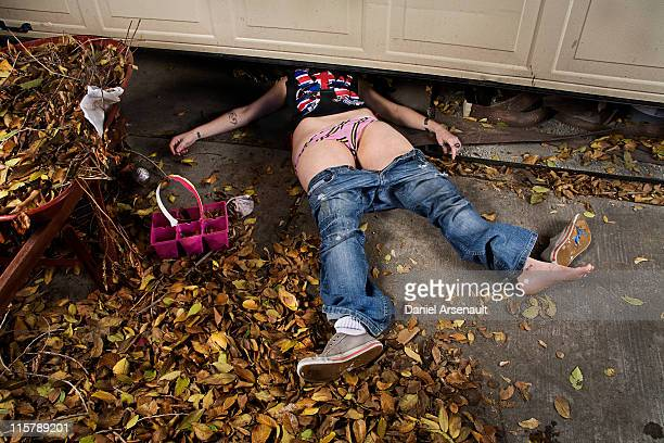 Woman, accident under garage door.