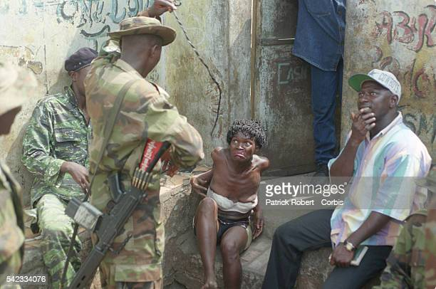 A woman accused of being a rebel is arrested at a checkpoint by the Nigerian army from Ecowas She will be badly beaten for hours to force her...