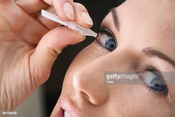 woman adding eyedrops - dry mouth stock photos and pictures
