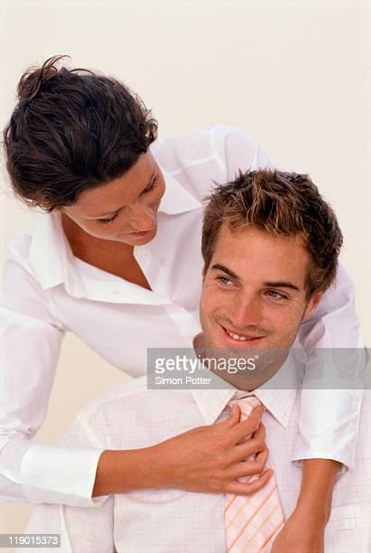 Woman adjusting boyfriends tie