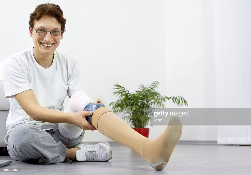 Woman Adjusting Her Artificial Limb : Stock Photo