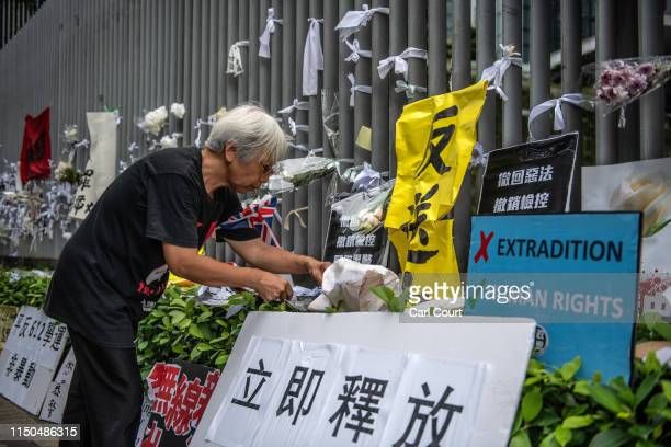 A woman adjusts a protest banner on the fence of the Legislative Council building on June 18 2019 in Hong Kong Hong Kongs Chief Executive Carrie Lam...