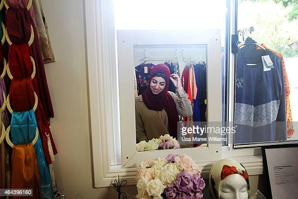 A woman adjusts her veil whilst shopping at Sara Elmir's home clothing studio on December 4 2014 in Bankstown Australia Sara Elmir 26 and mother of...