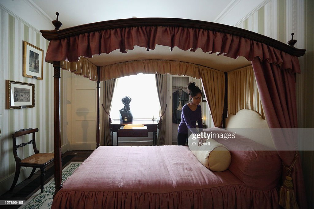 A woman adjusts the bed linen in a bedroom inside the Charles Dickens Museum on December 7, 2012 in London, England. The museum will re-open to the public on December 10, 2012 following a major 3.1 million GBP refurbishment and expansion programme to celebrate Dickens' bicentenary year. The museum is located in Charles Dickens' house on Doughty Street where he lived from 1837 until 1839 and in which he wrote many novels including Oliver Twist and Nicholas Nickleby.