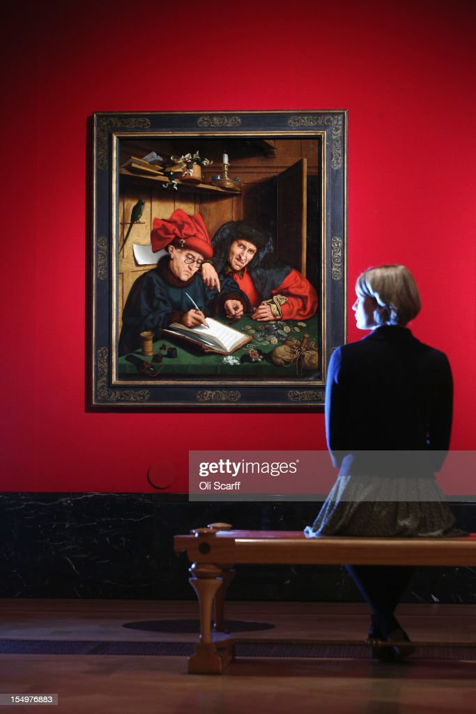 A woman admires a painting by a Follower of Marinus van Reymerswaele entitled 'The Misers' in the exhibition 'The Northern Renaissance: Durer to Holbein' at The Queen's Gallery on October 29, 2012 in London, England. The exhibition, which celebrates the Renaissance in Northern Europe through work by some of the finest artists of the era, opens to the general public on November 2, 2012 and runs until April 14, 2013.