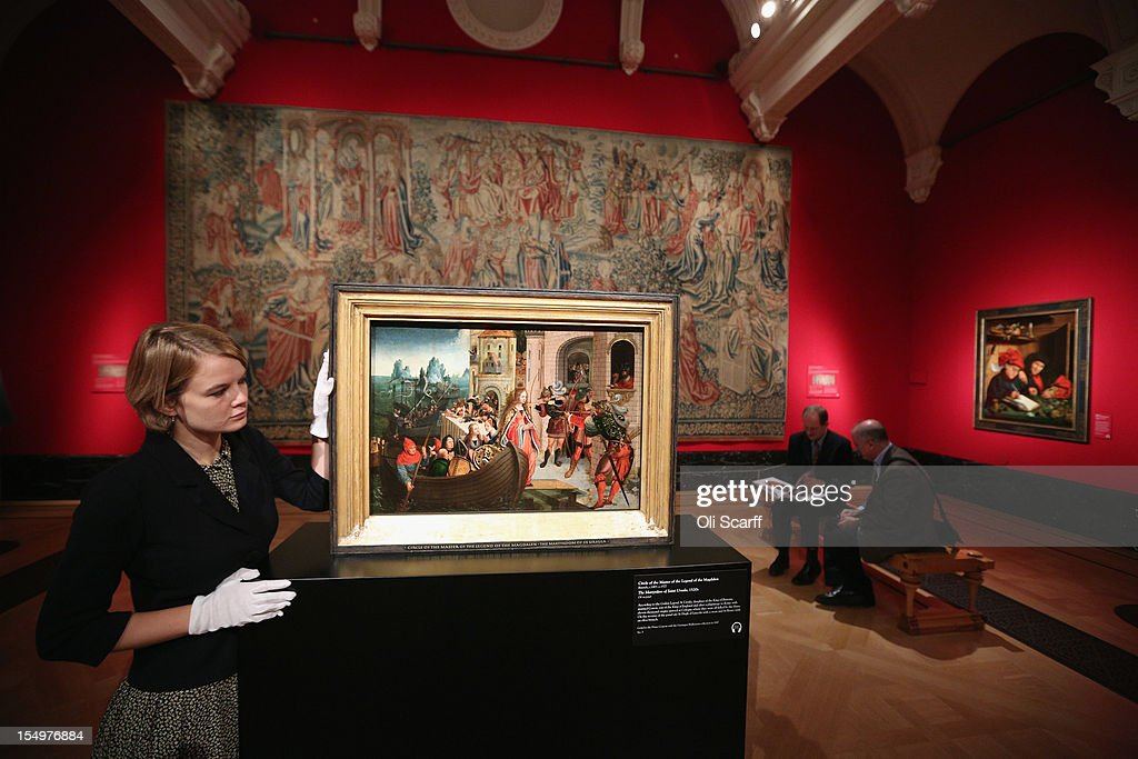 A woman admires a painting by 'Circle of the Master of the Legend of Magdalen' entitled 'The Martyrdom of Saint Ursula' in the exhibition 'The Northern Renaissance: Durer to Holbein' at The Queen's Gallery on October 29, 2012 in London, England. The exhibition, which celebrates the Renaissance in Northern Europe through work by some of the finest artists of the era, opens to the general public on November 2, 2012 and runs until April 14, 2013.
