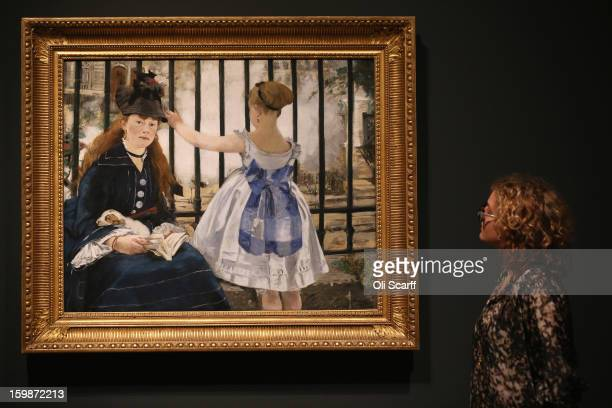 A woman admires a painting by Edouard Manet entitled 'The Railway' in the Royal Academy of Arts on January 22 2013 in London England The painting...