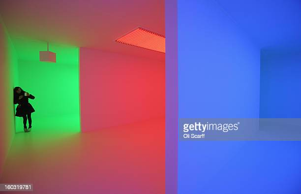 A woman admires an art installation by Carlos CruzDiez entitled 'Chromosaturation' which features in the Hayward Gallery's exhibition 'Light Show' on...