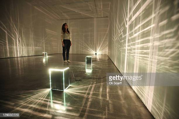 A woman admires an art installation by Kitty Kraus in the new White Cube gallery in Bermondsey on October 11 2011 in London England The third White...
