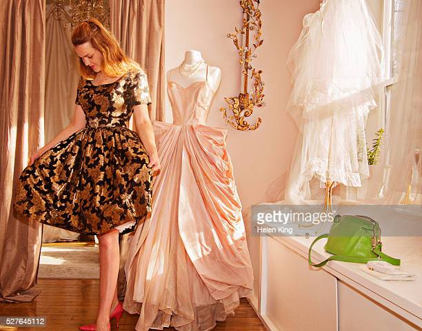 Woman admires evening dress