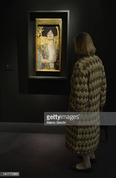 A woman admires 'Judith I' by Gustav Klimt during the press preview of the exhibition 'Gustav Klimt in the Sign of Hoffmann and the Secession' at...
