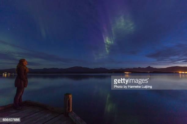 Woman admires Northern Lights in Tromsø