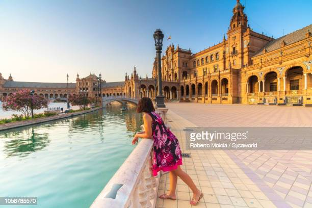 woman admires plaza de espana, seville - seville stock pictures, royalty-free photos & images