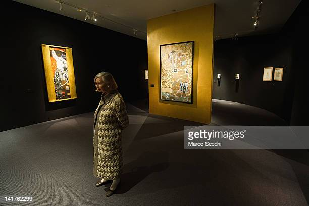 A woman admires some of the works by Gustav Klimt during the press preview of the exhibition 'Gustav Klimt in the Sign of Hoffmann and the Secession'...