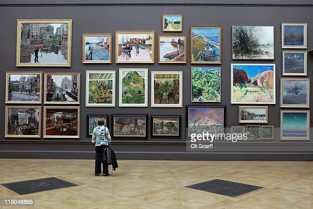 Woman admires the artwork on display in the Royal Academy of Arts' Summer Exhibition on June 2, 2011 in London, England. The Summer Exhibition is the...