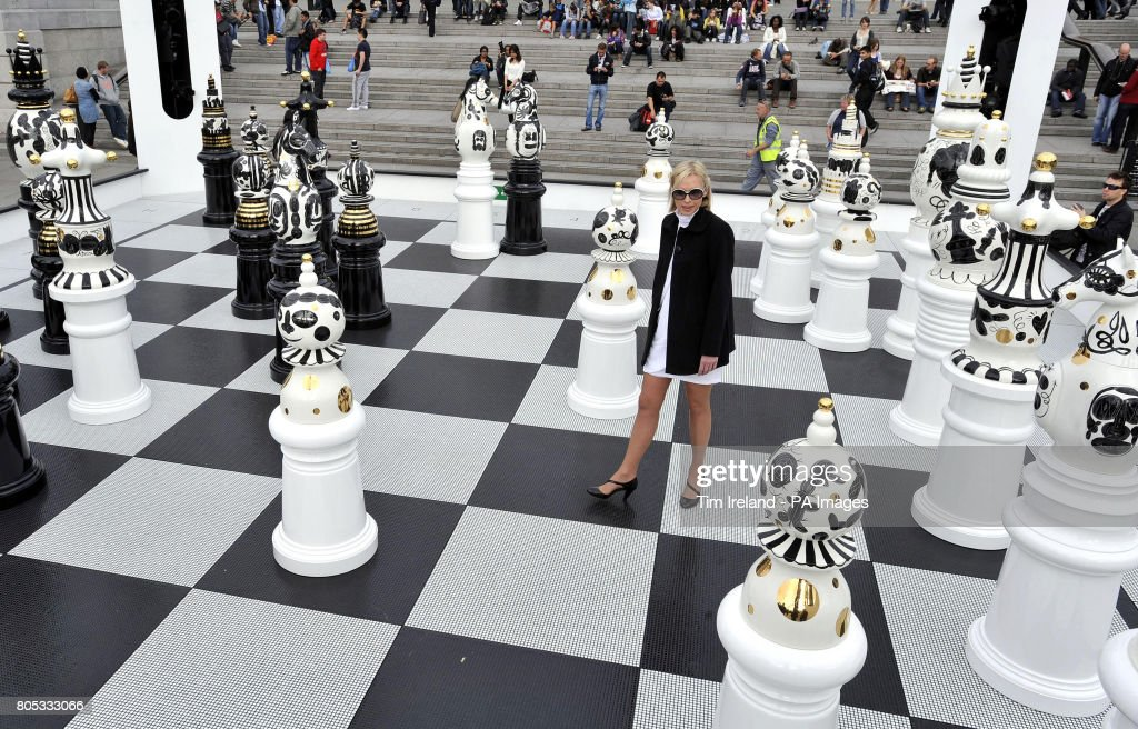 A Woman Admires The Giant Chess Pieces Which Form The Tournament, An  Installation By Spanish