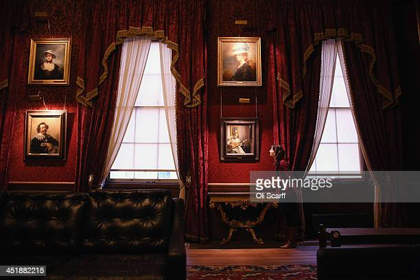 A woman admires the paintings inducing Johannes Vermeer's 'The Guitar Player' in the Dining Room of English Heritage's Kenwood House on the northern...