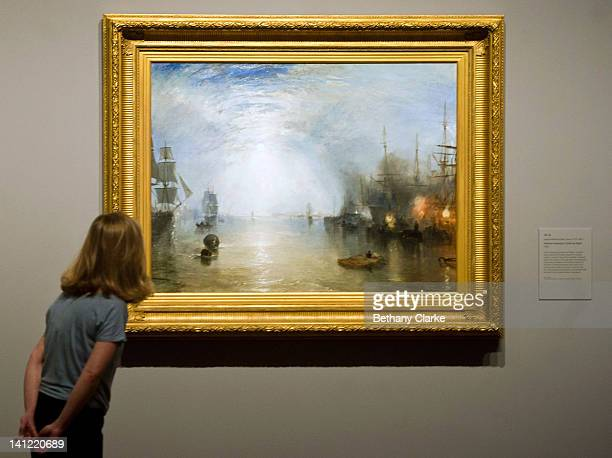 A woman admires Turner's 'Keelmen Heaving in Coals by Night' as the National Gallery unviels their new William Turner exhibition on March 13 2012 in...