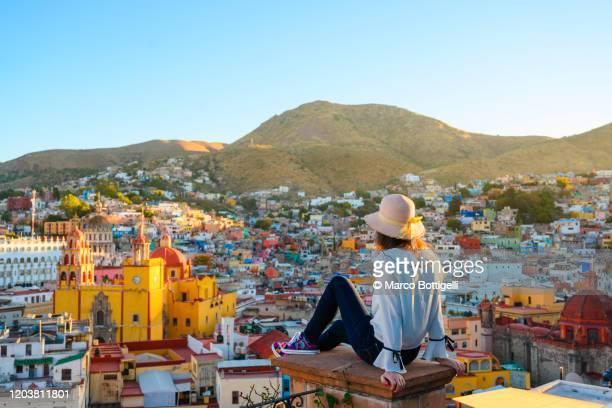 woman admiring guanajuato city and the basilica, guanajuato, mexico - destino de viagem imagens e fotografias de stock