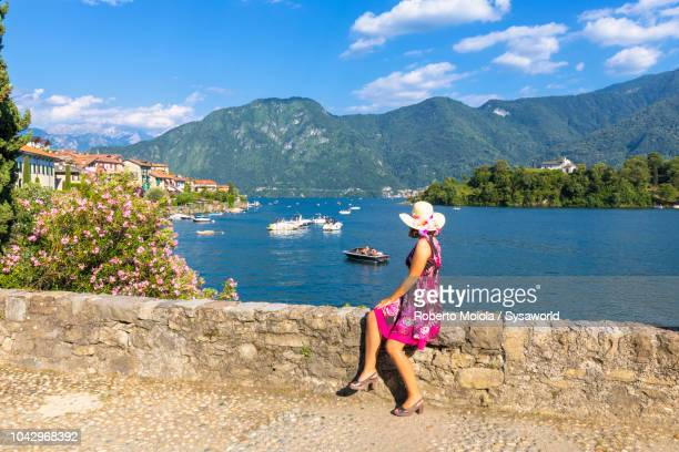 Woman admiring Isola Comacina, Lake Como