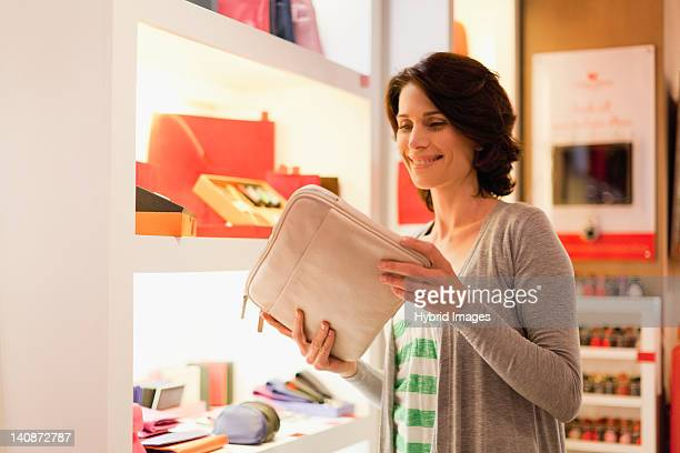 Woman admiring laptop case in store