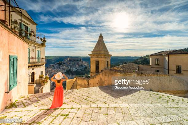 woman admiring santa maria delle scale church and ragusa ibla in the background, ragusa, sicily, italy, europe - sicily stock pictures, royalty-free photos & images