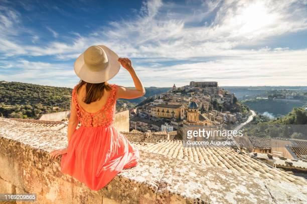 woman admiring the church of santa maria dell'itria and ragusa ibla in the background, ragusa, sicily, italy, europe - sicily stock pictures, royalty-free photos & images