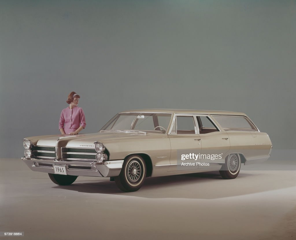 a woman admiring the new pontiac bonneville station wagon for 1965 1959 Pontiac Safari Station Wagon a woman admiring the new pontiac bonneville station wagon for 1965 news photo getty images