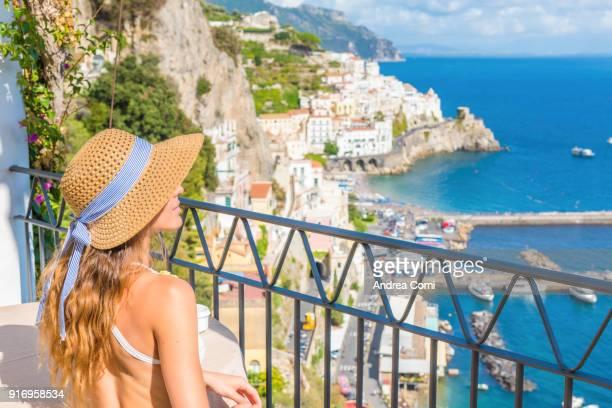 Woman admiring the view of Amalfi. Amalfi, Amalfi coast, Salerno, Campania
