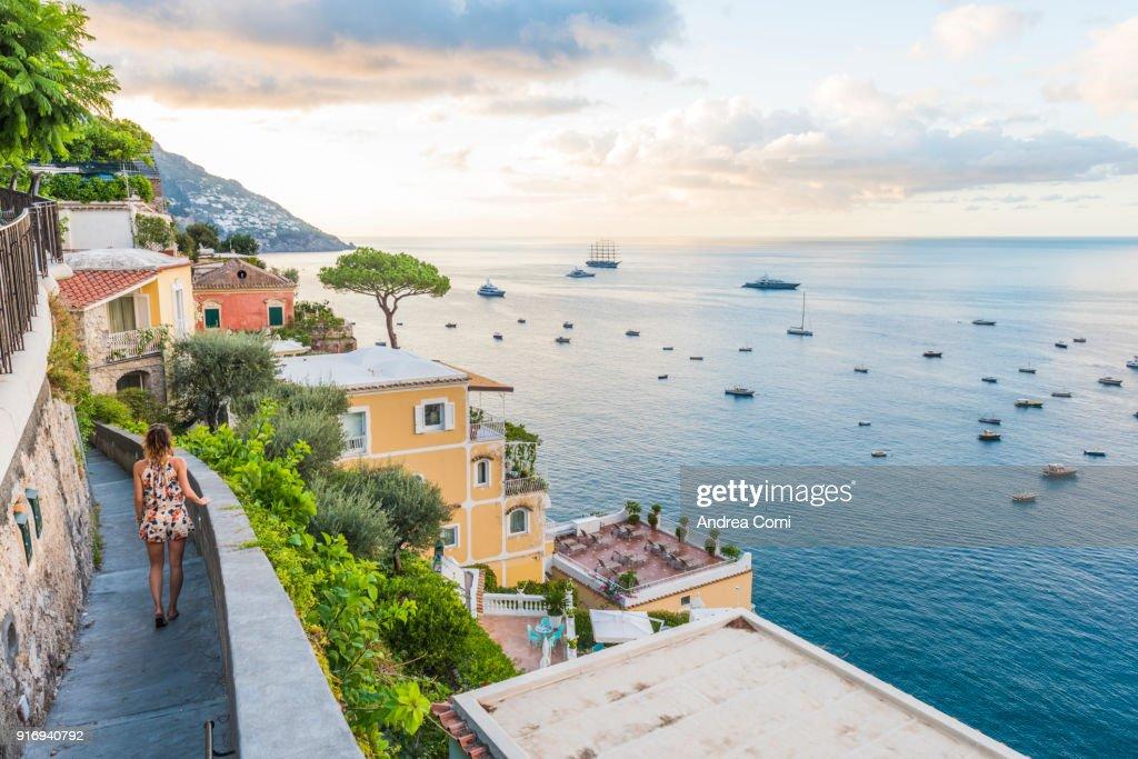 Woman admiring the view of Positano village : Stock Photo