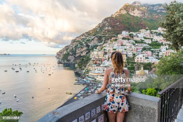 Woman admiring the view of Positano village. Positano, Amalfi coast, Salerno, Campania