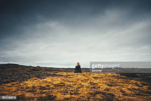 Woman Admiring The Volcanic Landscape In Iceland