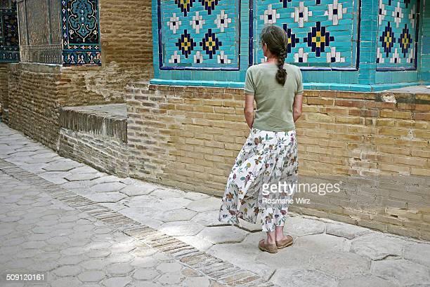 Woman admiring tilework