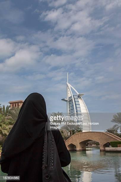 Woman admiring urban architecture